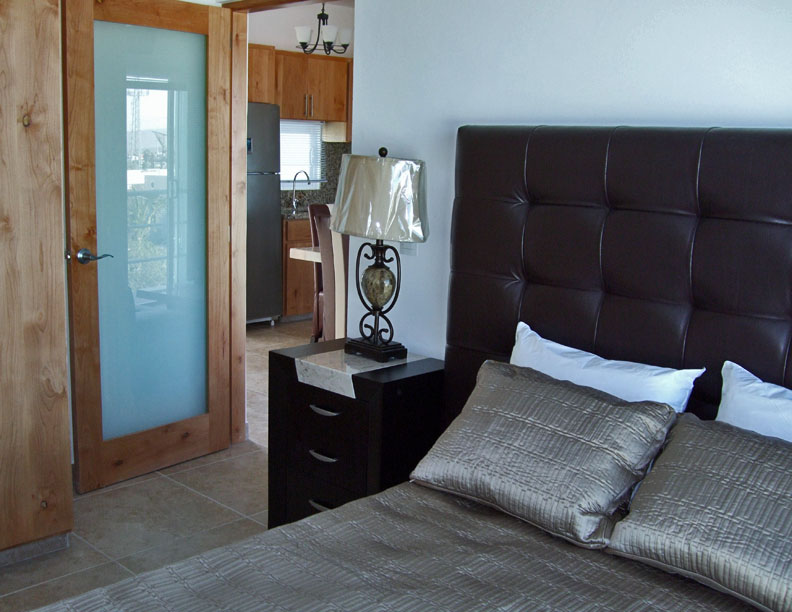 This second bedroom has a double bed, a large closet with drawers and a plasma screen TV and DVD player. The guest bath is right next door. You will wake up to lovely views!